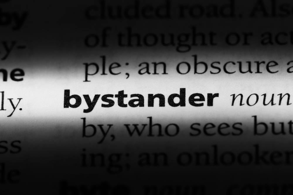 Survival Can Hinge on Actions of Bystanders